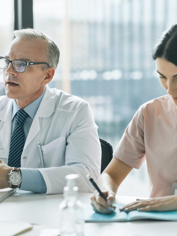 Medical Professionals at Meeting Table